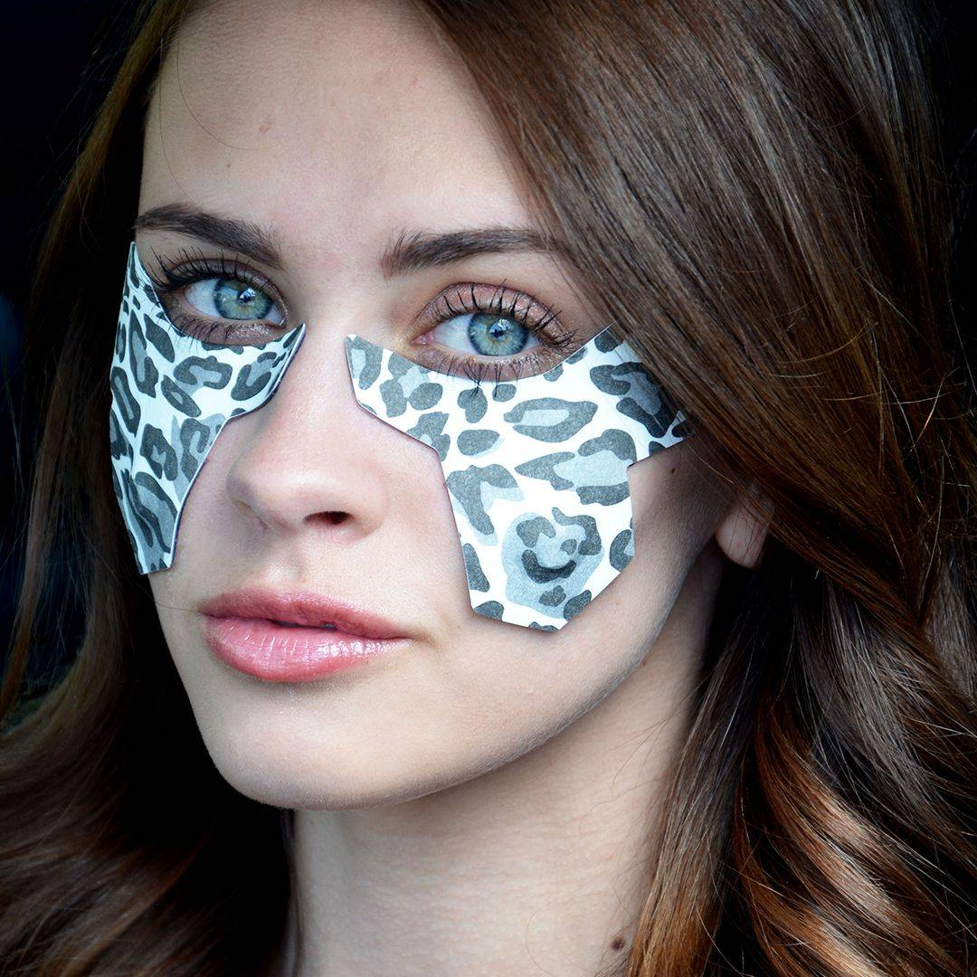 woman wearing deppatch under eye reusable hydrogel microcurrent patch system