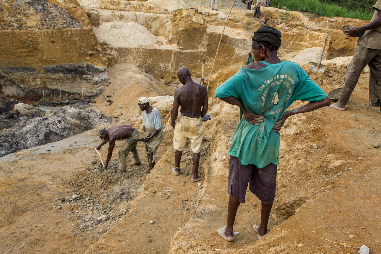 People in Africa digging at conflict diamond mine