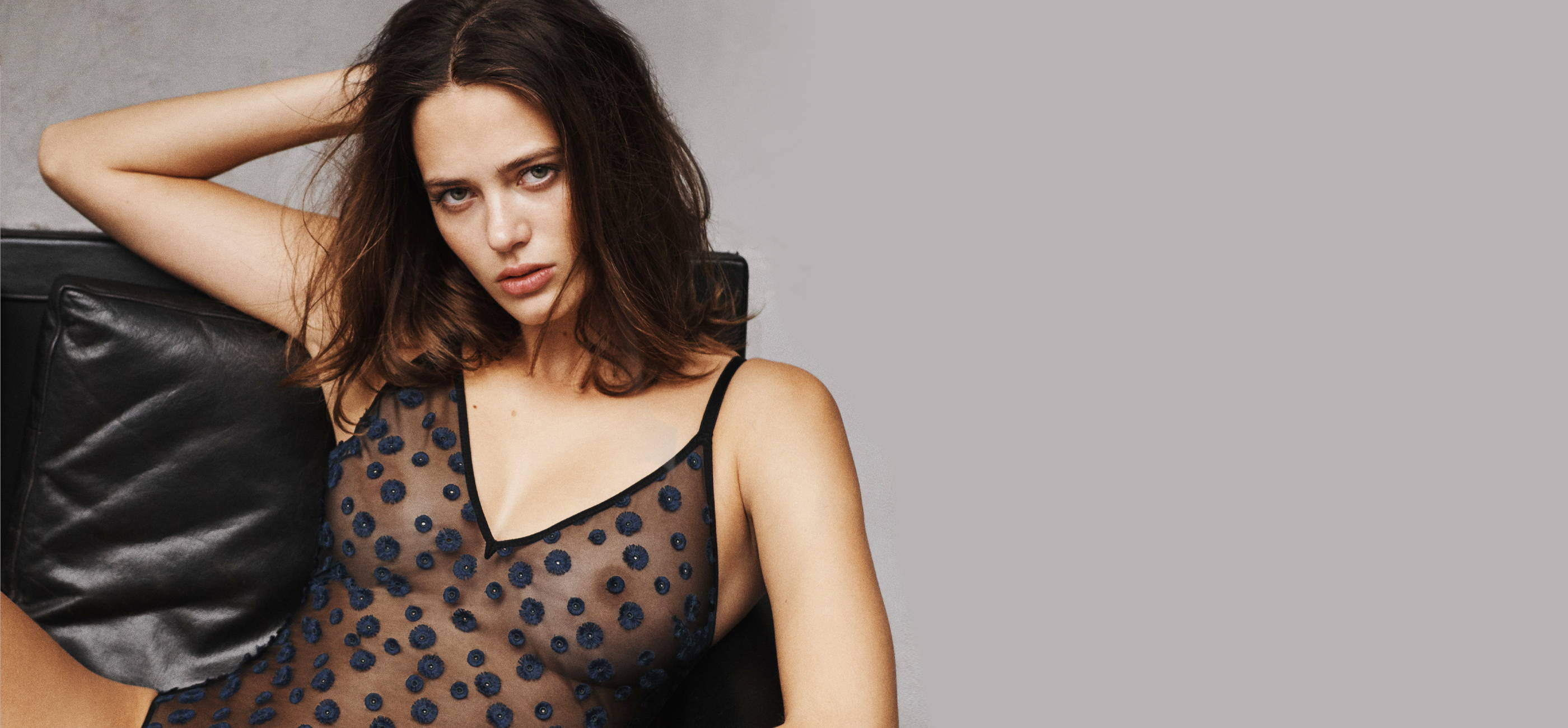 Woman wearing the Simone Perele Lingerie Cassie Bodysuit featuring intricate embroidered details and comfortable mesh material