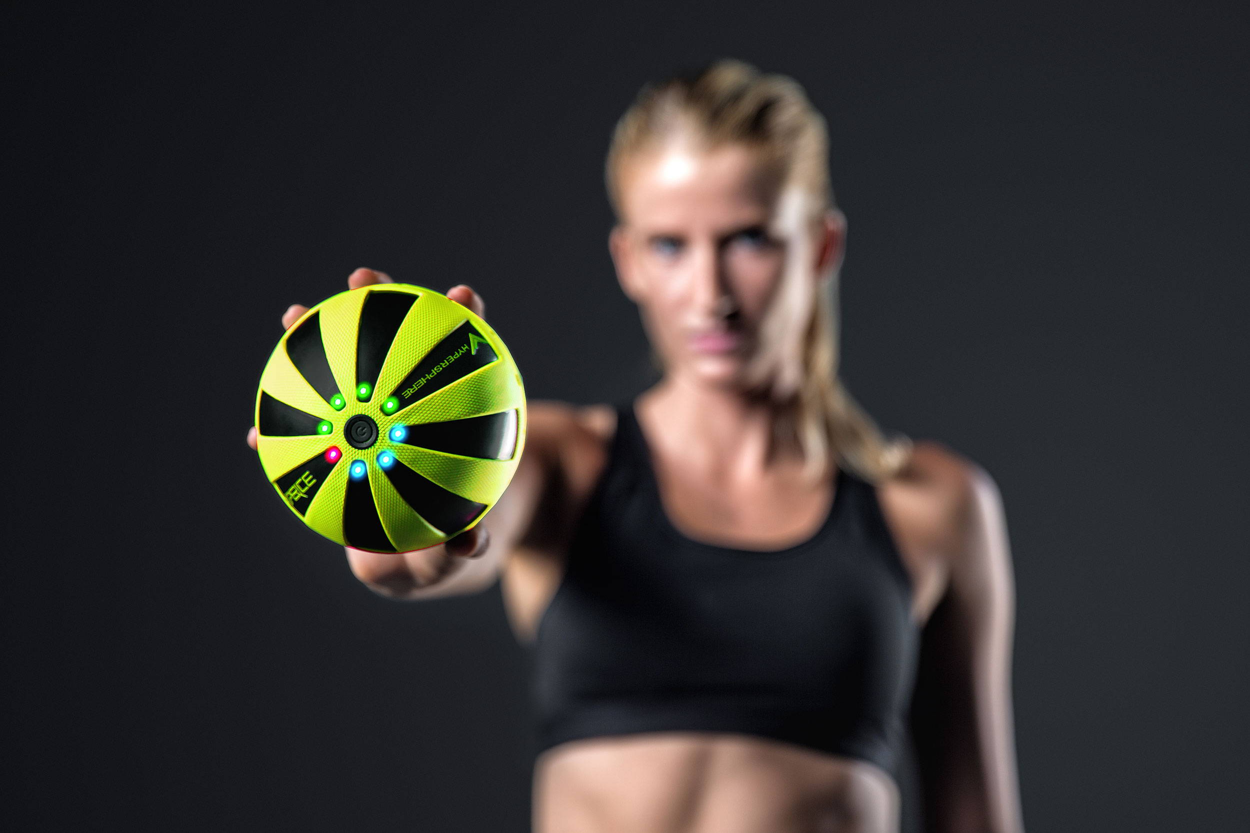 Woman holding Hyperice Hypersphere