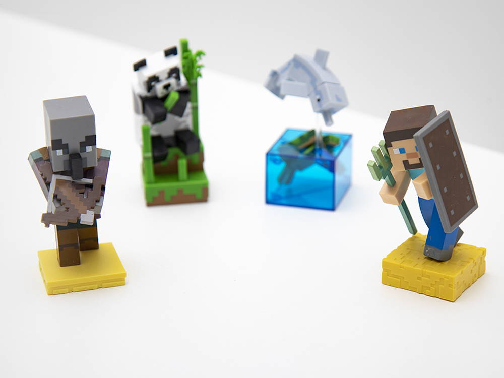 A collection of four Adventure Figure vinyl toys