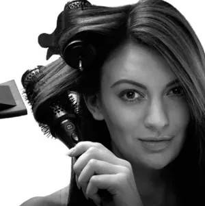 Girl drying hair with curlers