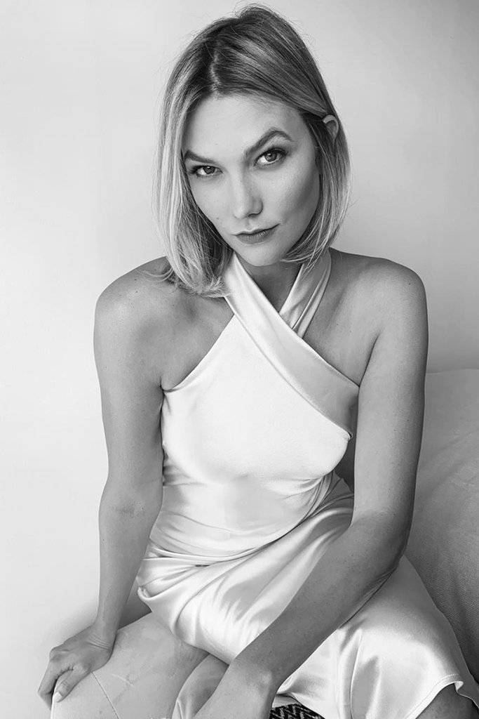 Karlie Kloss wearing Galvan London Asymmetrical Halter Neckline Satin White Cropped Bridal Dress