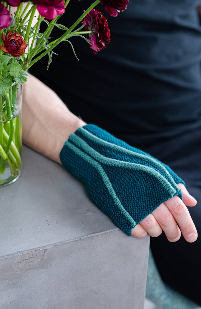 Image of Brian modeling Limn mitts