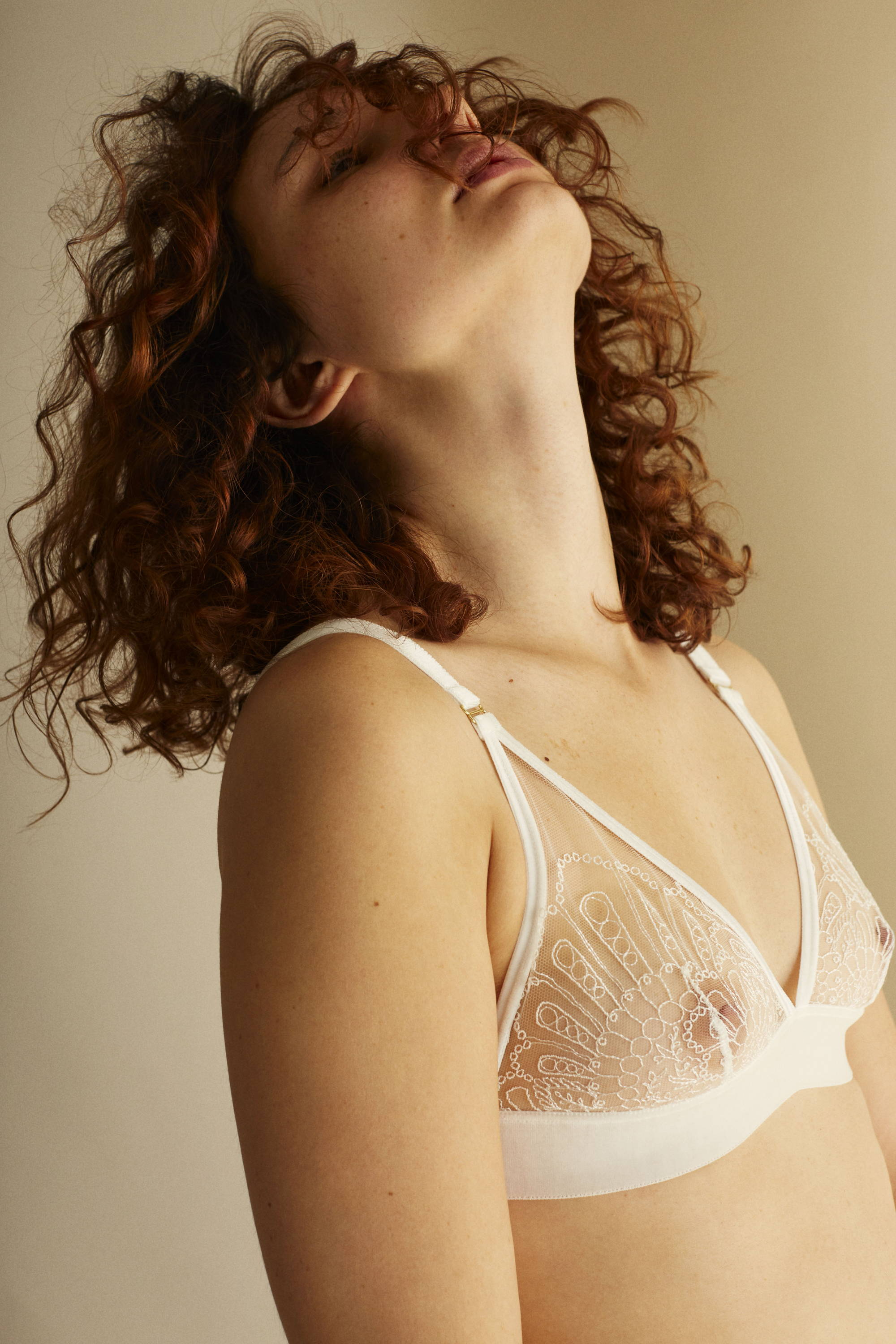 Woman wearing The Underargument For Love Against Conforming Triangle Bra