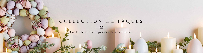Couronne et guirlande de Pâques avec bougies TruGlow de différentes couleurs et formes.