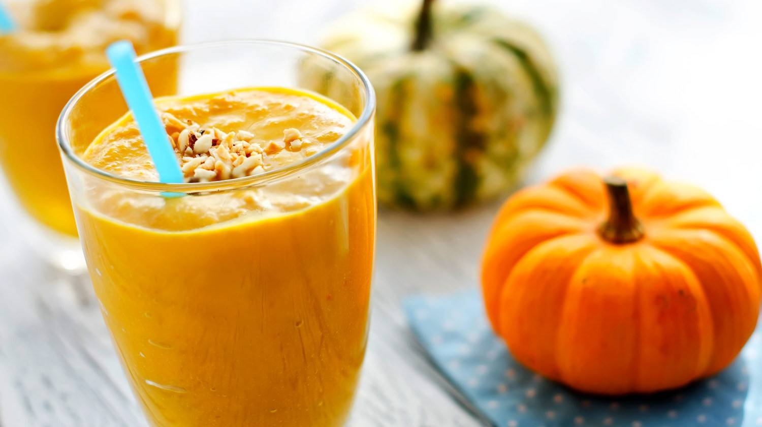 Beverage with pumpkins and milk wooden background | Best Protein Pumpkin Smoothie Recipe To Fill You Up This Fall | green smoothie recipe | Featured