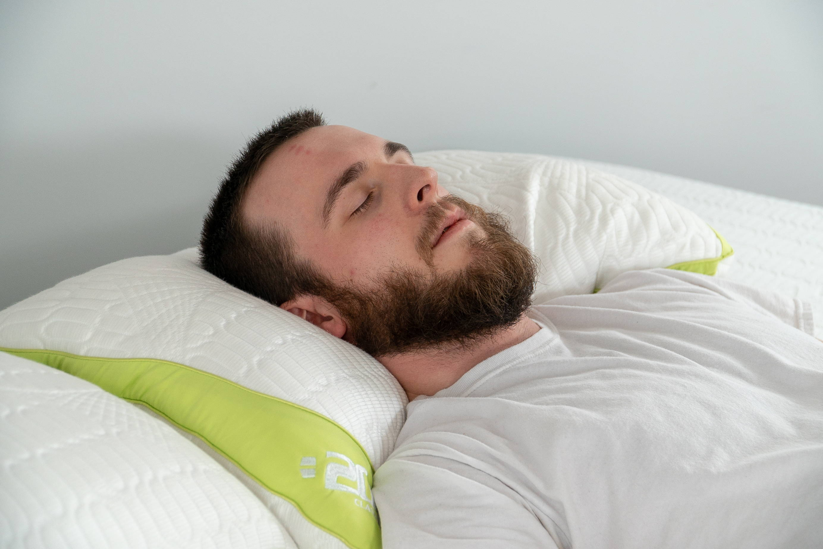 What Type of Mattress is Best for Me?. man sleeping on back on 200 cooling pillow