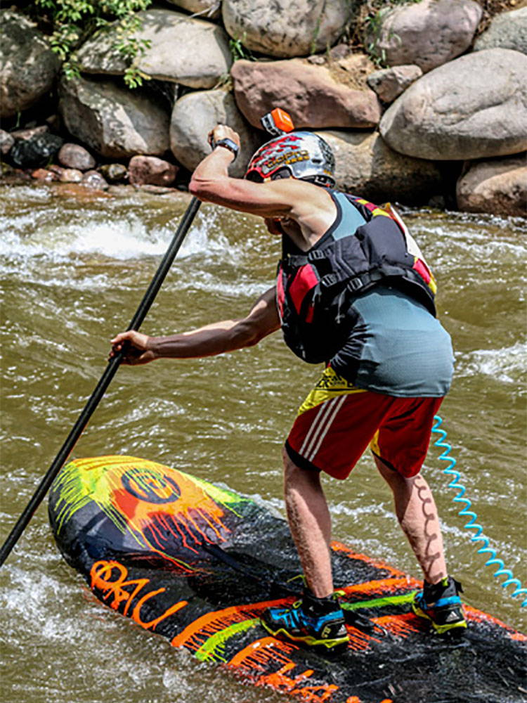 Paddling white water on an SUP