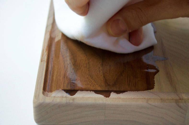 rub seasoning oil into a cutting board to season it and hydrate  the wood fibers