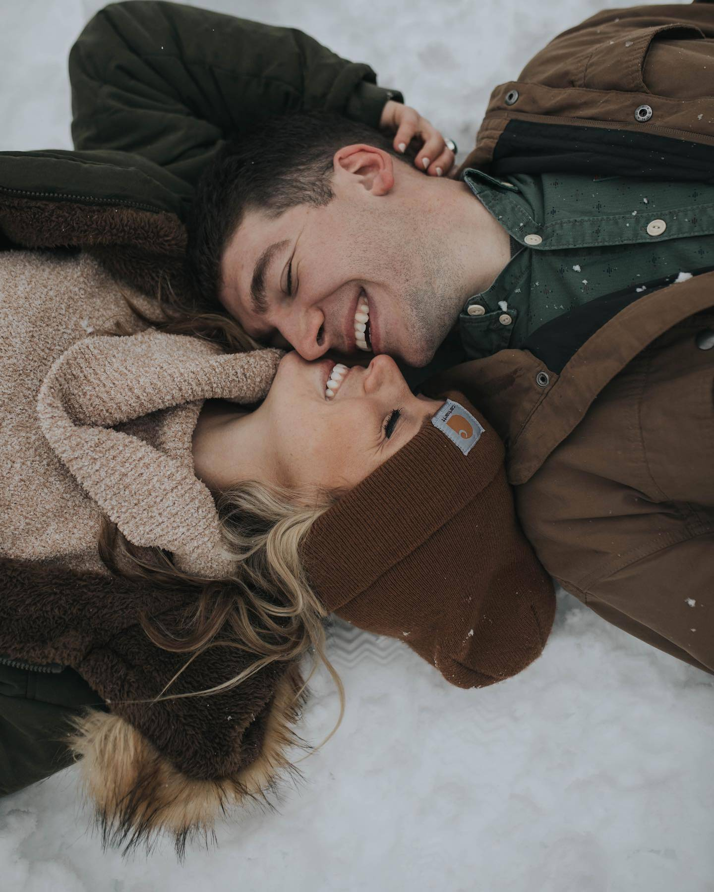 Henne Engagement Ring Couple Matthew & Montana Huddled in the Snow