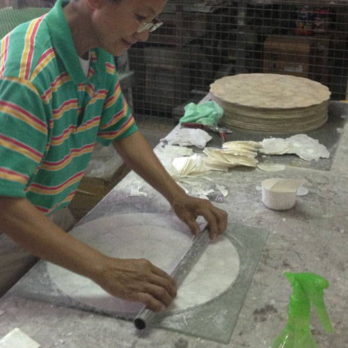 Artisan making capiz placemat