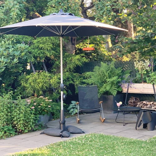 Parasol base from Baser with  market parasol in a beautiful garden