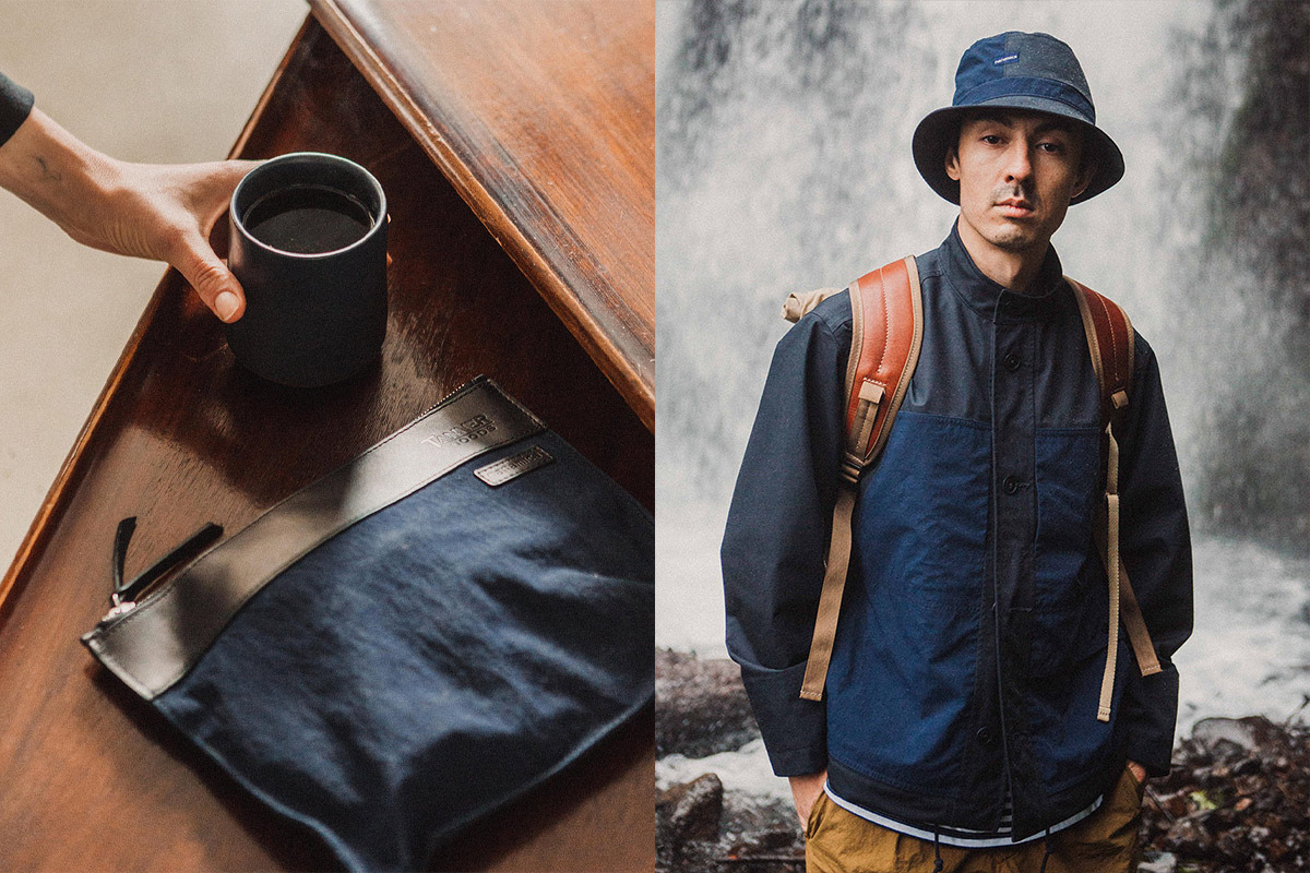 Tanner Goods + Nanamica products including a ceramic mug, zippered pouch, and model wearing a chore coat and bucket hat in front of a waterfall.