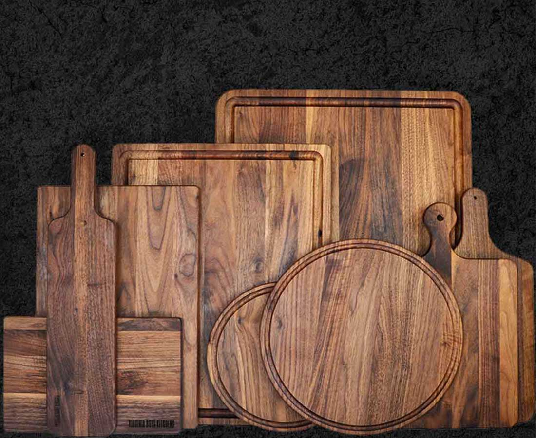 A collection of walnut wood boards that are perfect for plating charcuterie