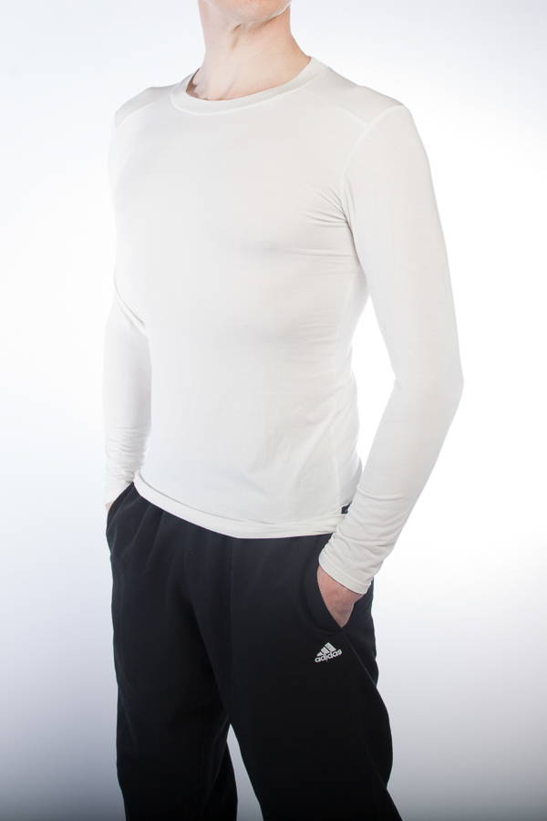 A man posing in tracksuit and crew neck sports undershirt in white