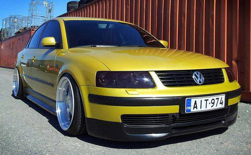 Audi with Gunsmoke Lamin-x headlight film covers