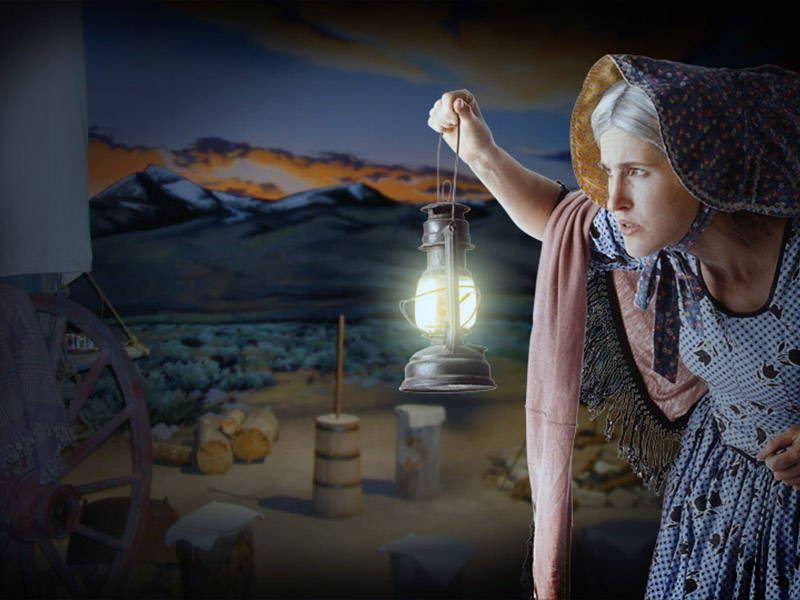 A Pioneer woman with a lantern at the Oregon Trail Center