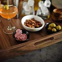 With 4 easy to carry handles, this wooden tray is perfect for serving cocktails and appetizers