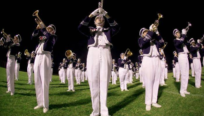 Marching band playing outside on field