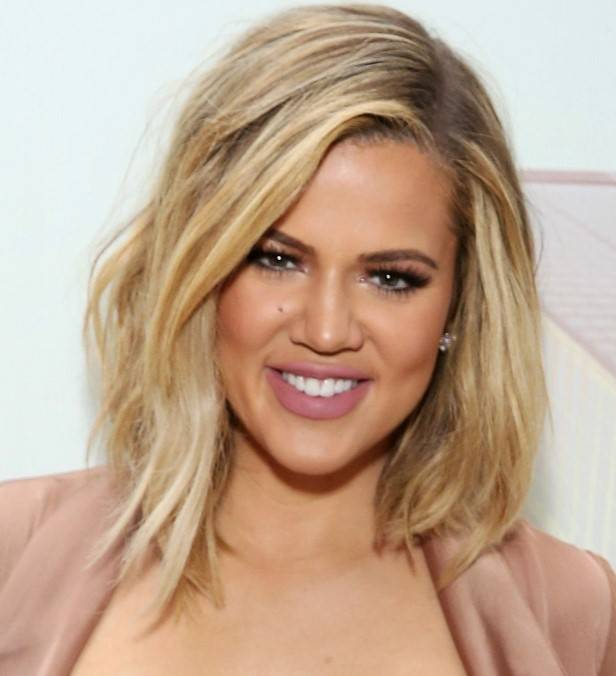 Khloe Kardashian with a short blonde angled bob