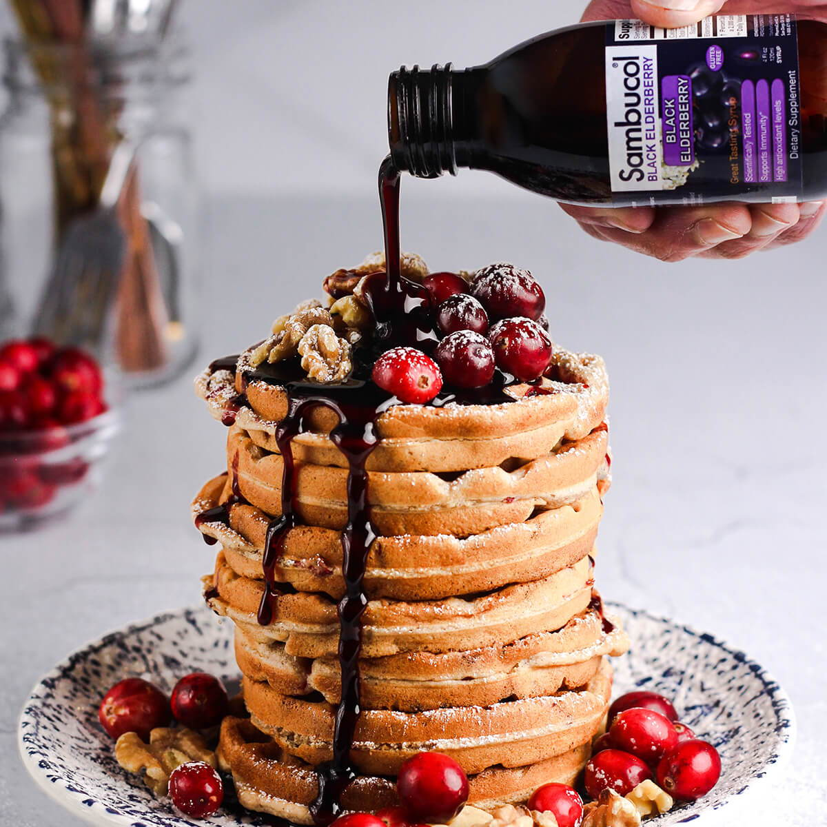 Sambucol Black Elderberry syrup drizzled over waffles