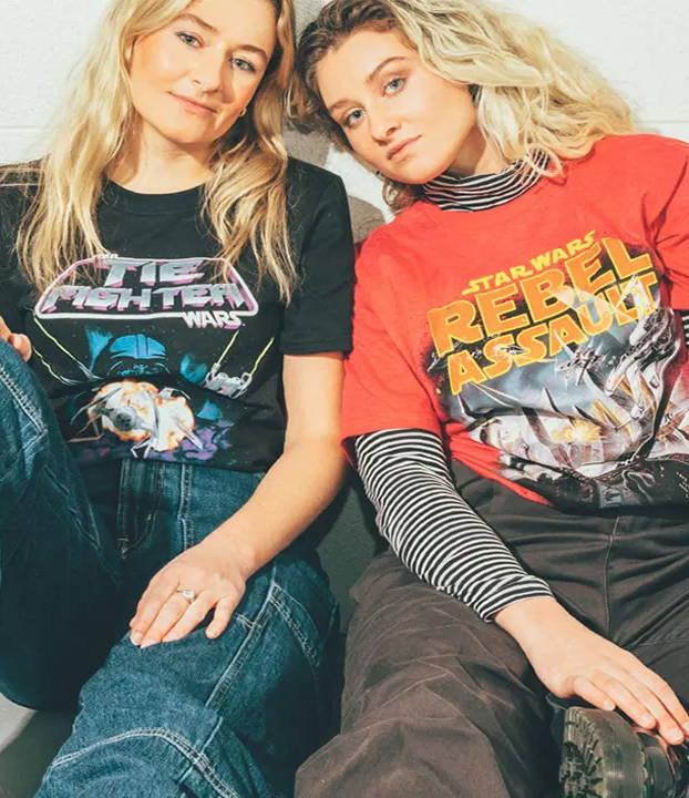 Two models wearing Star Wars tee shirts
