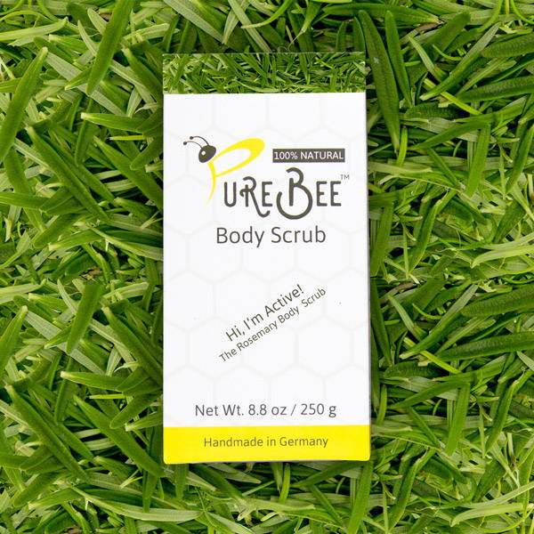 A Box of PureBee Active Rosemary an a bed of rosemary leafs