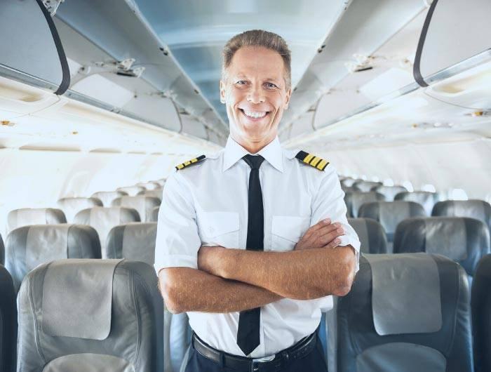 Pilot wearing a black pre-tied necktie