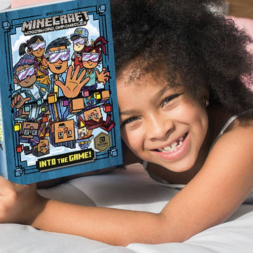 Girl enjoying Minecraft comic book picture.