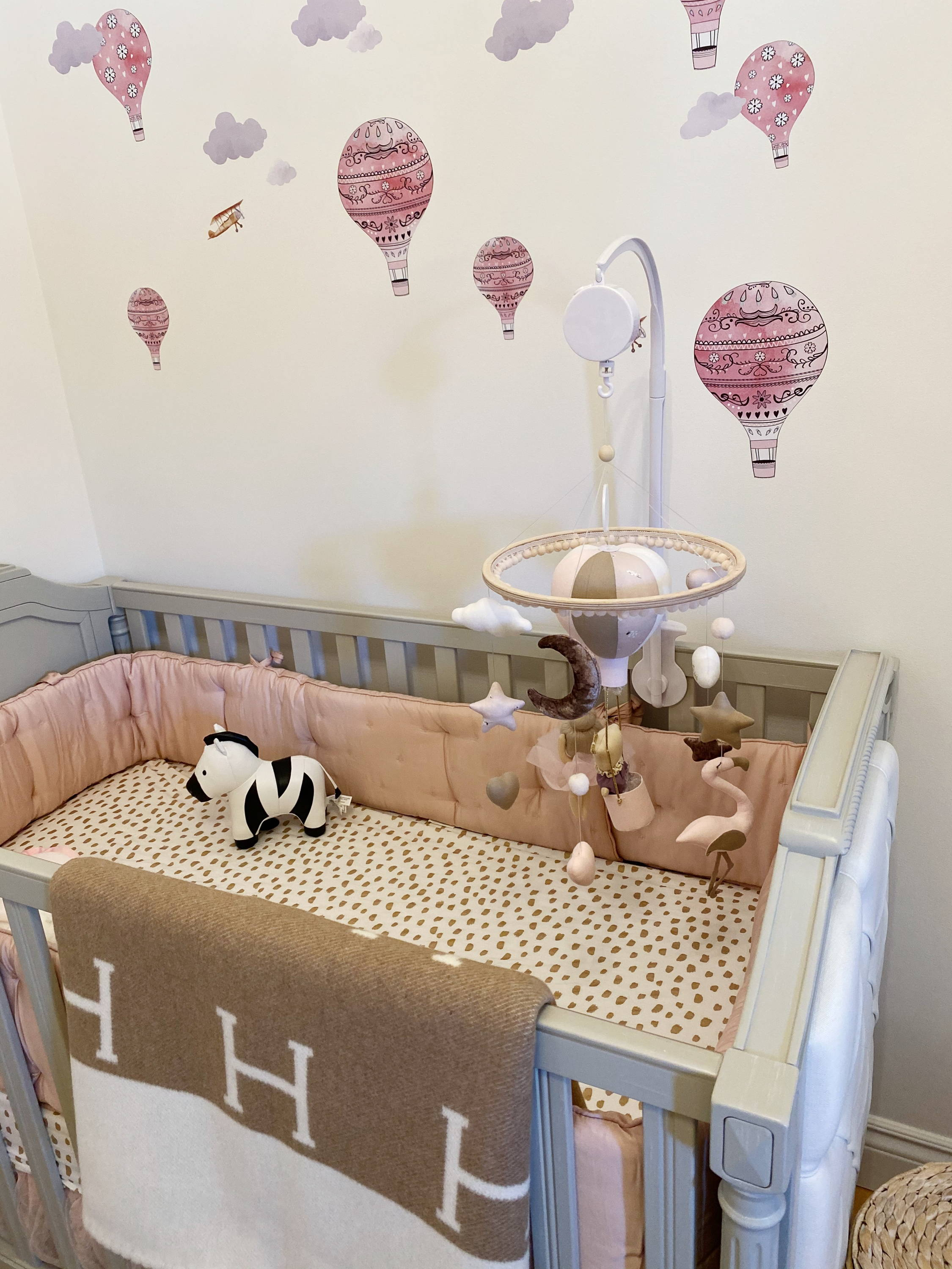 blythe crib from pottery barn kids in a nursery with hermes avalon blanket