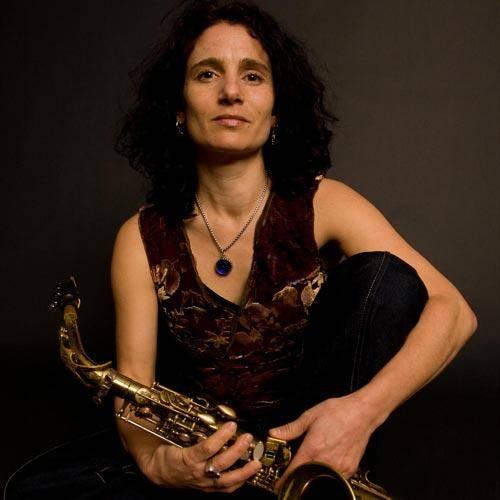 Jessica Lurie holding a Selmer Mark VI saxophone
