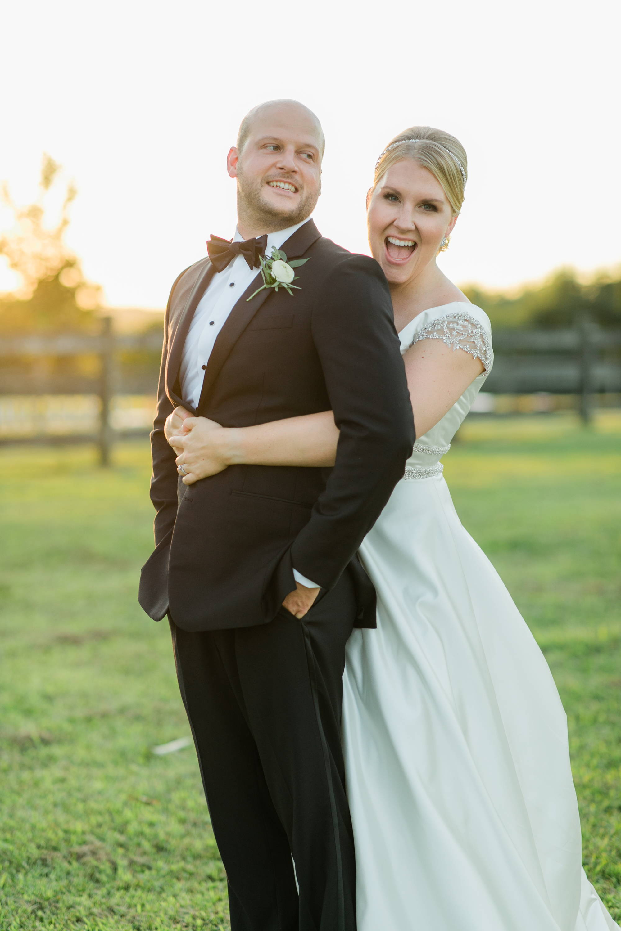 Henne Engagement Ring Couple Charlie & Skylar Smiling Outdoors on Their Wedding Day