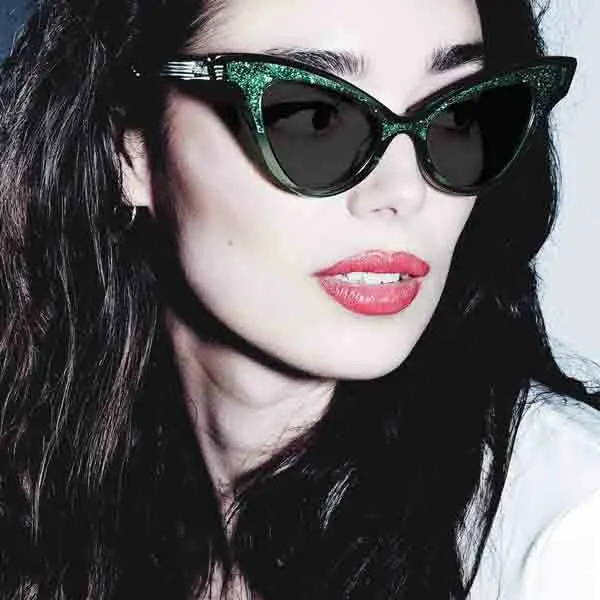 Female model wearing joiuss glimmer clear emerald cat eye sunglasses