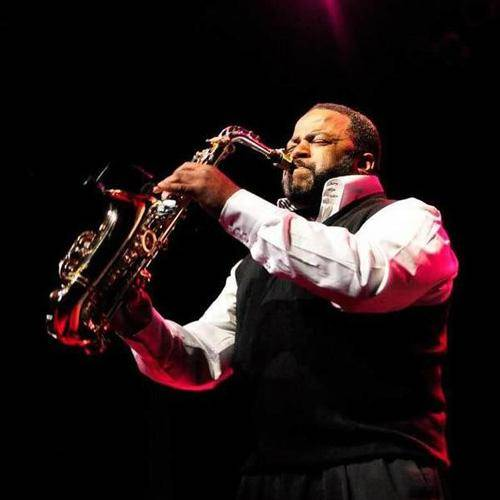 Saxophonist Issac Parham playing alto sax