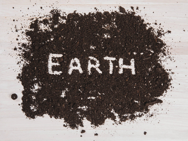 Soil with earth written in it