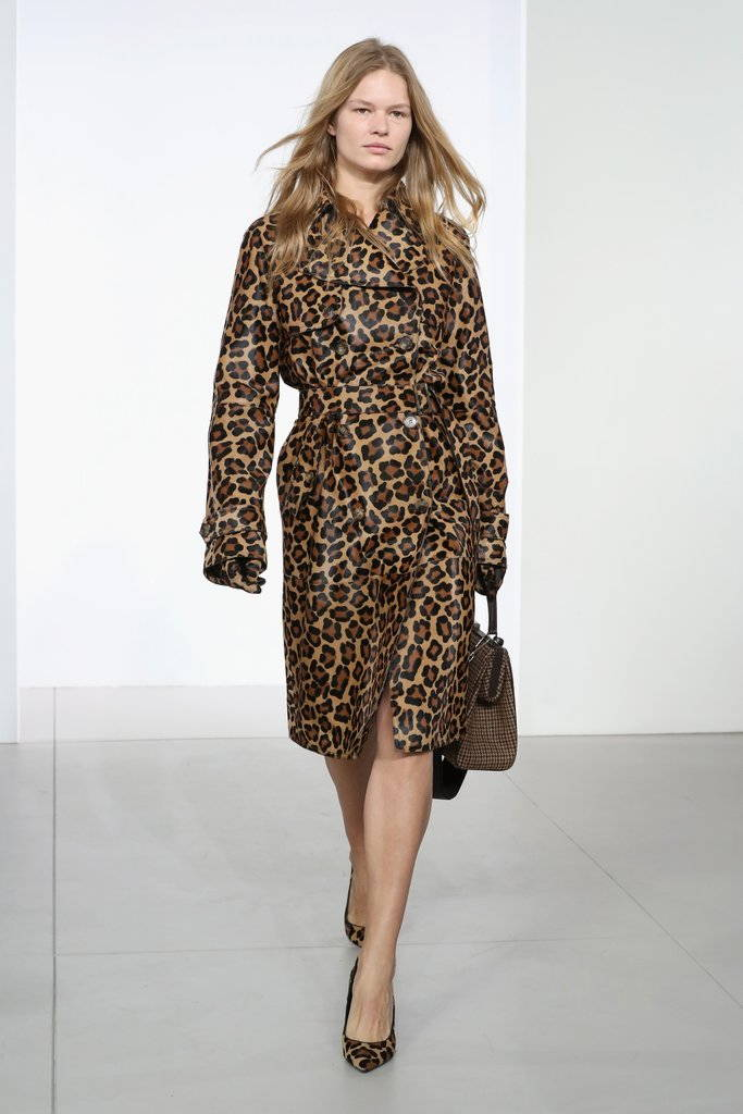 Girl on runway in animal print coat