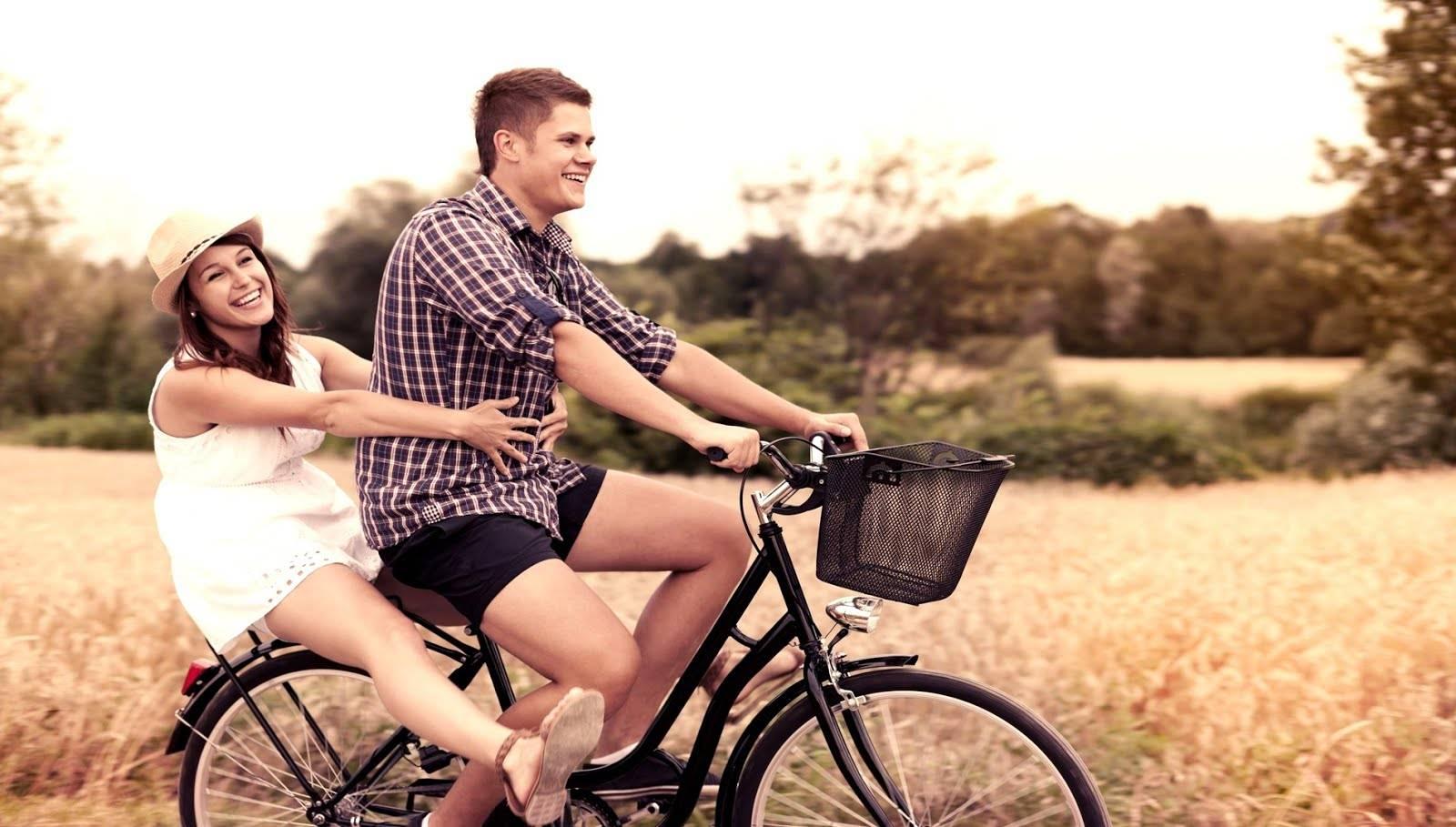 Couple riding a bike having fun
