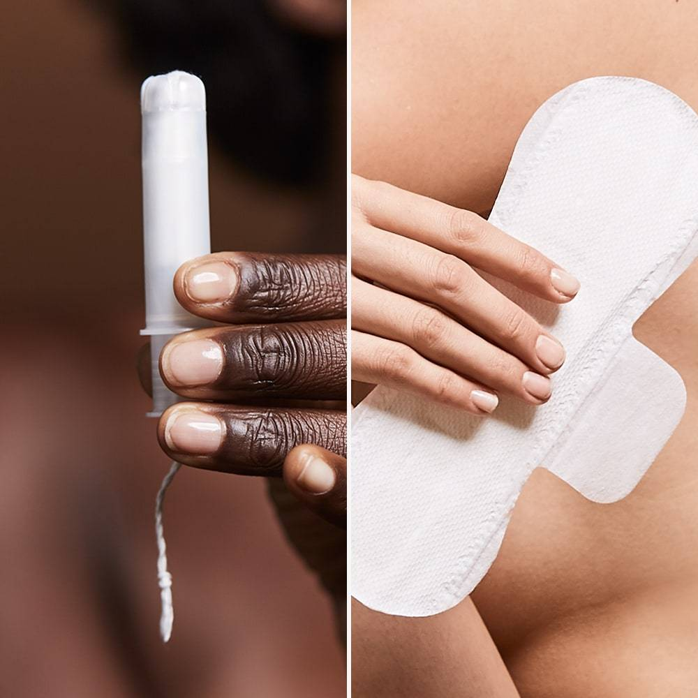 A black woman's hand holding an organic tampon, next to a white woman's hand holding a Cora period pad