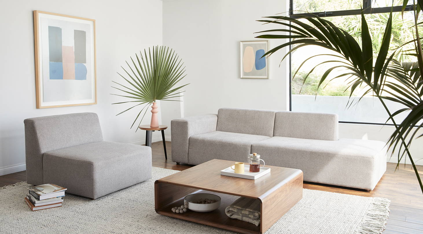 A Floyd Sectional in a modern living room with plants.