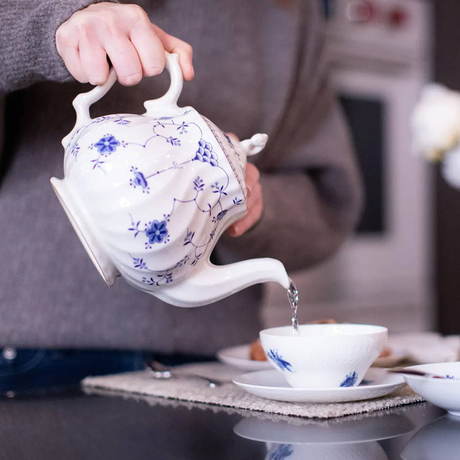 myott finlandia blue and white teapot pouring water for tea
