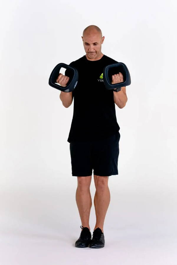 """Aaron """"Az"""" Lawrence performs a dumbbell twist curl with a set of YBells"""