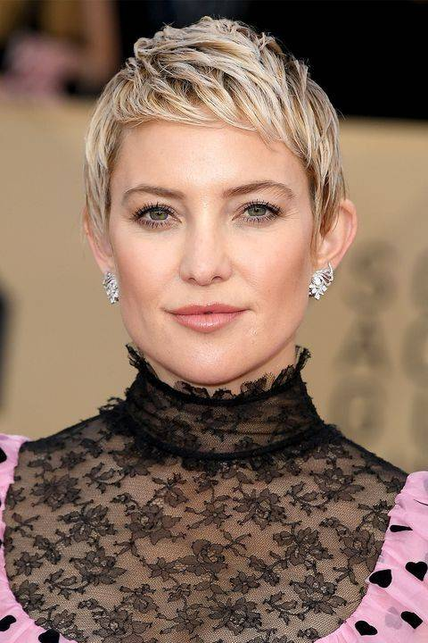 Woman with blonde chopped pixie cut