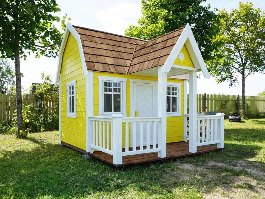Wooden Playhouse in yellow colour with a Gambrel Roof and wooden terrace by WholeWoodPlayhouses