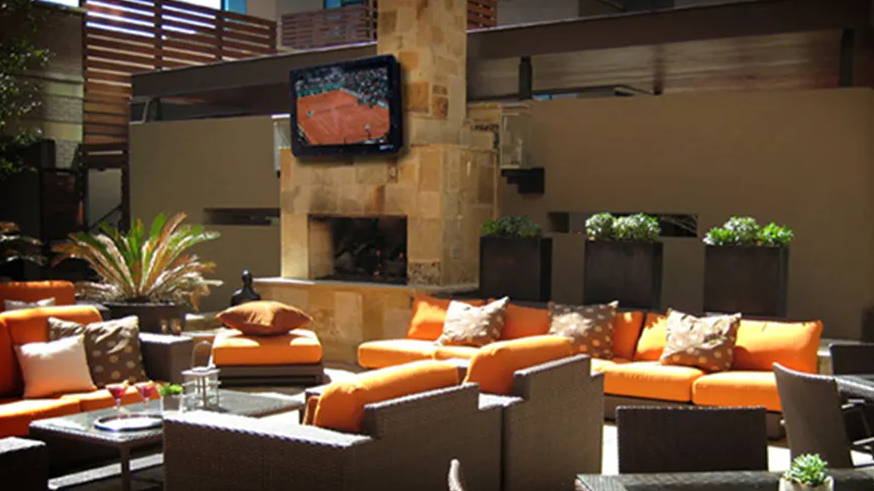 Outdoor TV cabinet above fireplace at restaurant for hotel,