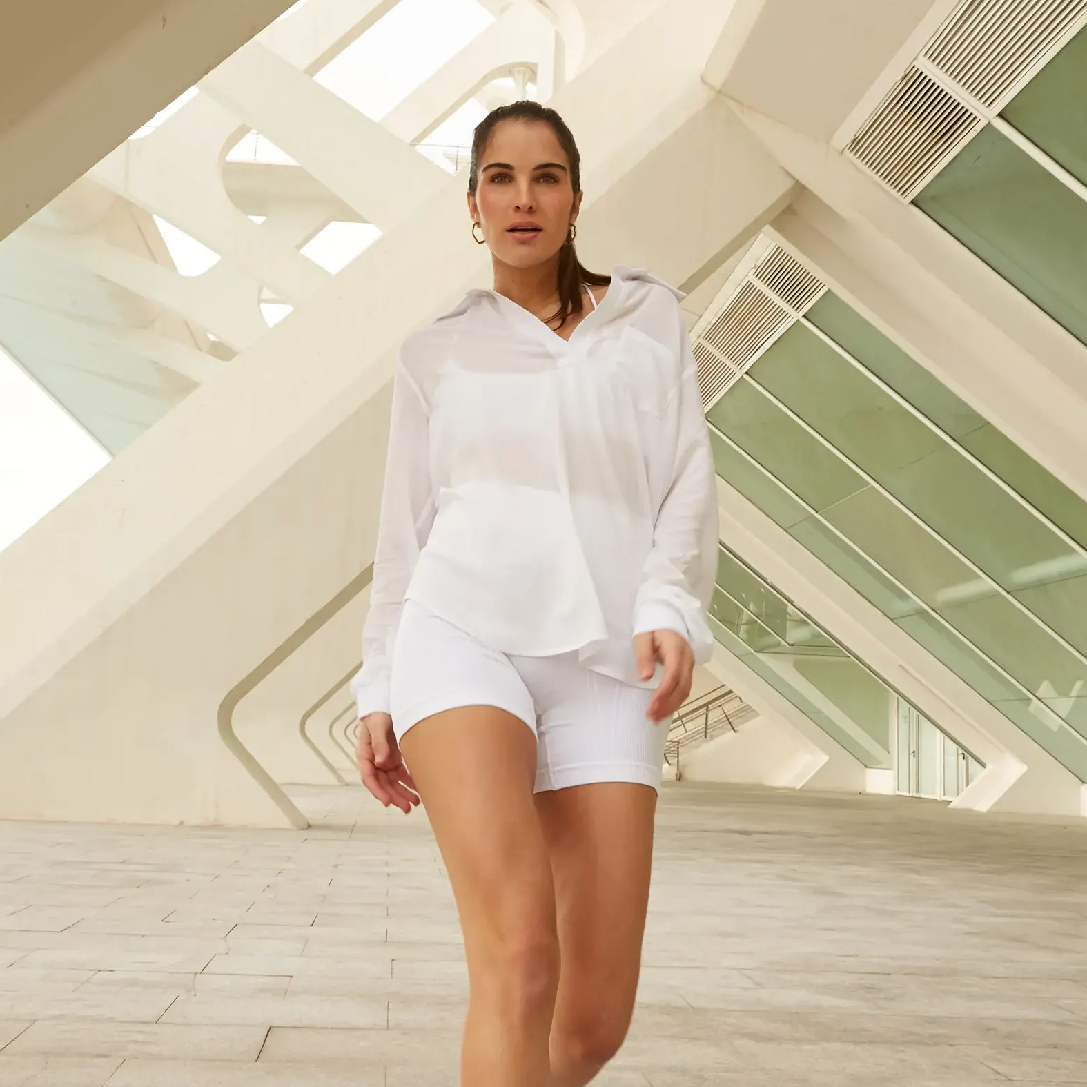 Background photo featuring our Diana Top and Barre Seamless Short in White.