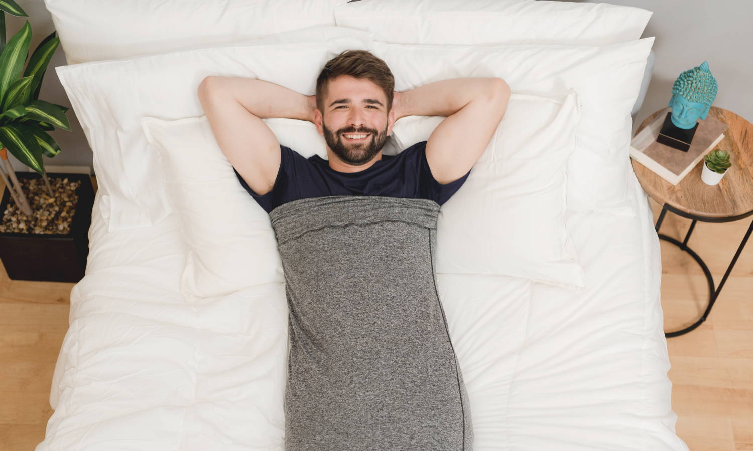 man in sleep pod lounging in bed