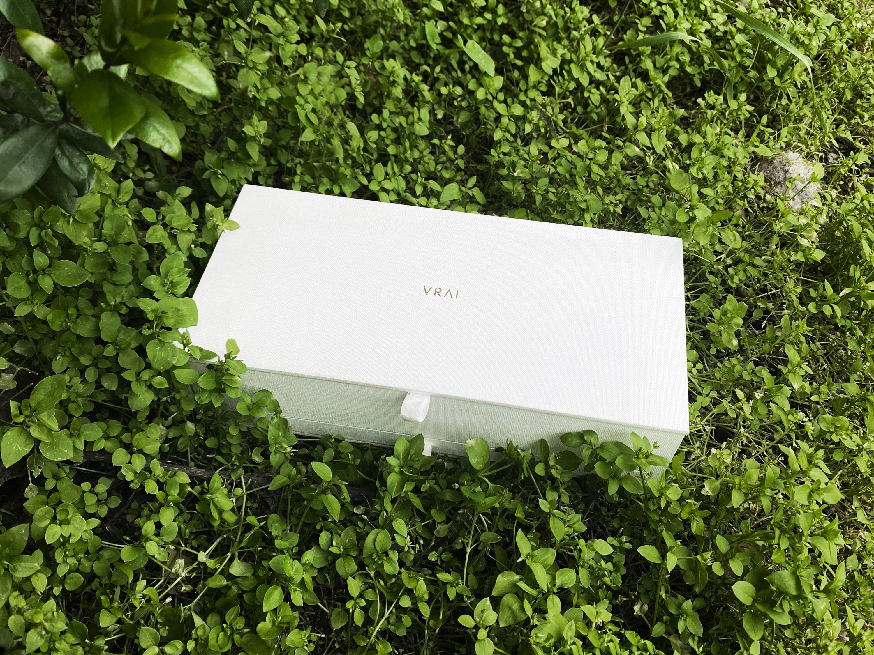 Vrai sustainable white packaging in green bush