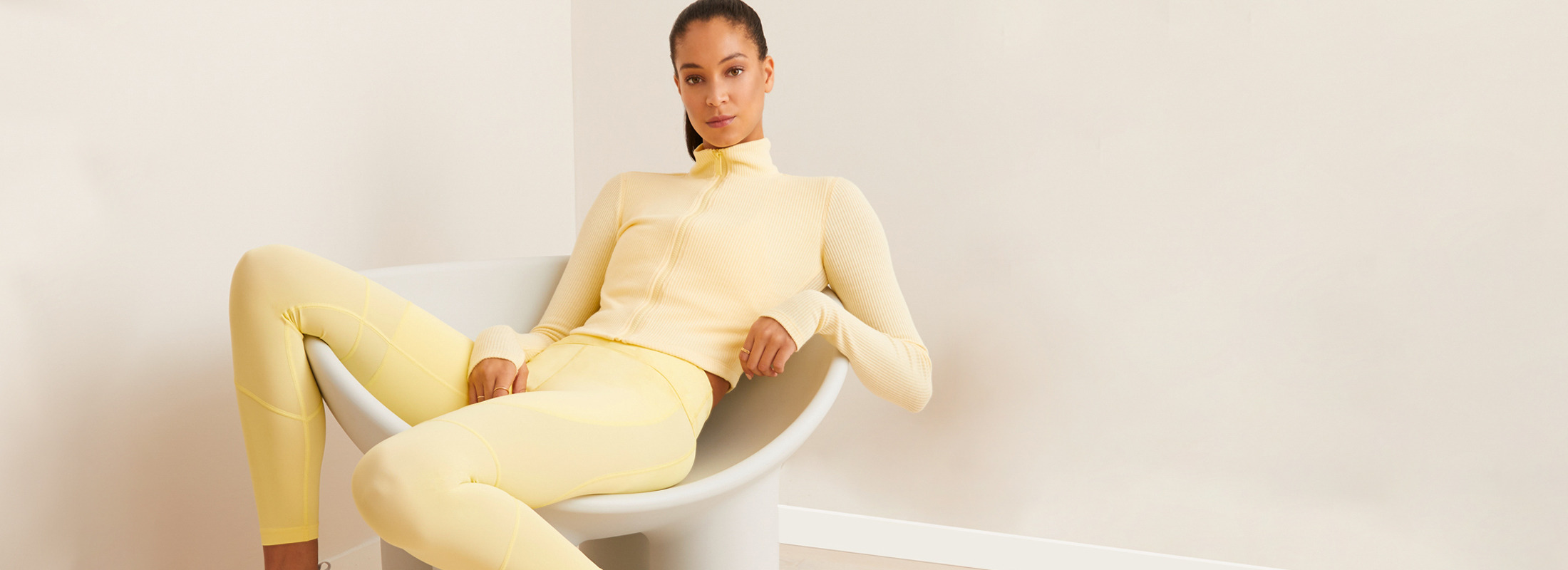 Photo of a woman sitting in a chair in our New Buttercup Set.