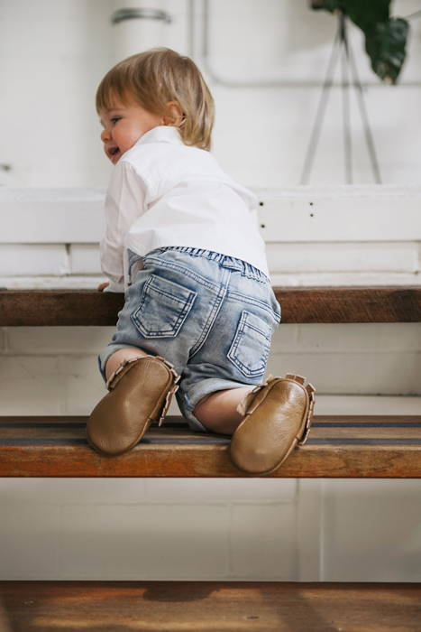 Boy climbing stairs in soft sole shoes